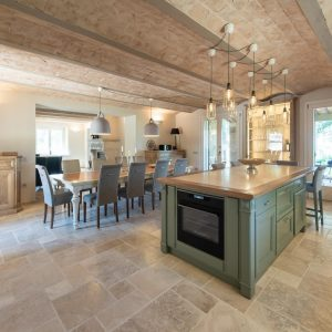 Kitchen with island, in solid wood and natural stone