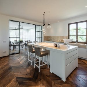 kitchen with a clean design. In solid wood and natural stone